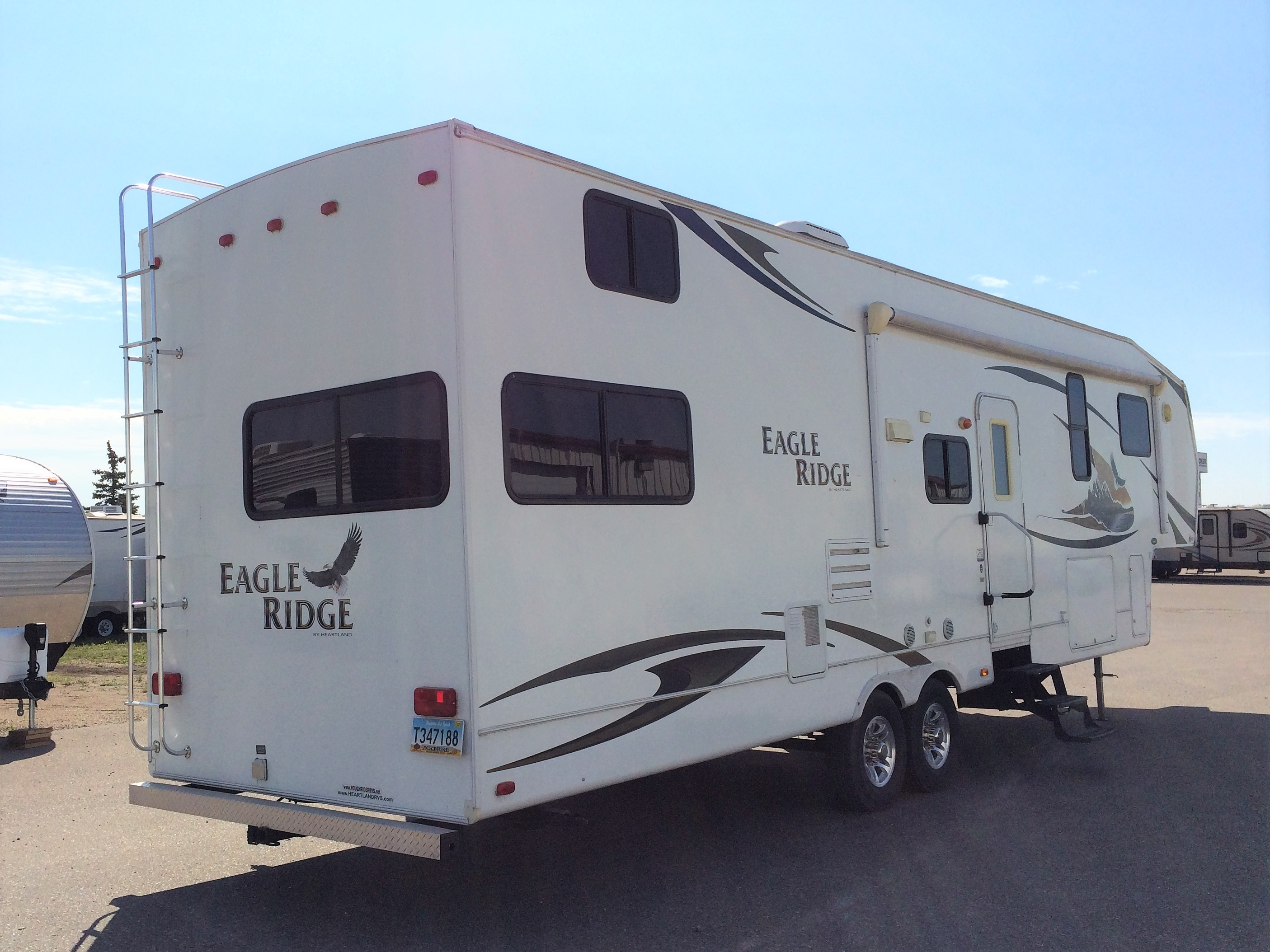 10FW3054 2010 Heartland Eagle Ridge 35DSRL Price $23 500